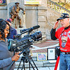 Veterans were interviewed by TV news reporters.