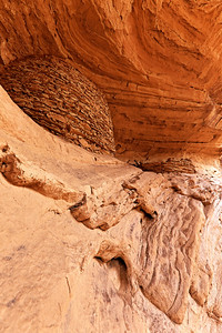 Grainery beneath an arch, Monument Valley, AZ