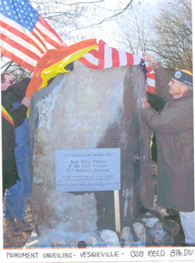 "Vesqueville, Belgium<br />   <br /> This new Monument that was dedicated on the 60th Anniversary Battle of the Bulge Tour, <br /> December 10-21, 2004. <br /> <br /> This monument was dedicated by the 87th Infantry Division at Vesqueville, Belgium, where they fought.<br /> <br /> Bob Reed, HdQrts-345 and Eric Urbain, a young Belgian who lives in Bras, <br /> were instrumental in promoting this monument. <br /> <br /> The text written in French, and translated  reads as follows:<br /> <br /> ""To the Memory of the men of  Task Force Fickett; <br /> French 4th BN SAS; 87th Infantry Division.<br /> who fought in this sector between Dec. 25,1944 and January 11, 1945.""<br /> <br />     ""To those who have fallen, that they not be forgotten"".<br /> <br /> Shown unveiling the monument is Robert Reed, HDQtrs-345."