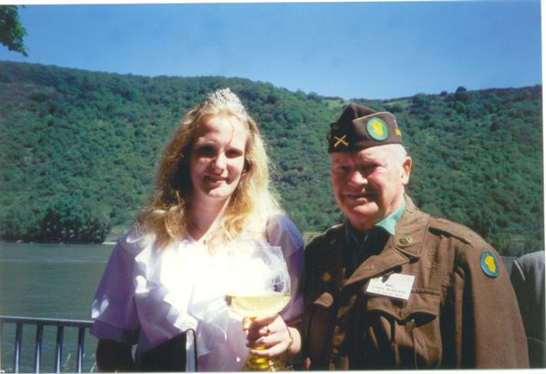 "SYLVIA  I,  Bopparder Weinkoningin - (Wine Queen 1995-96) and <br /> ""Mac"" John McAuliffe, M-347<br /> <br /> June, 1996 - Boppard, Germany<br /> 87th Infantry division Association Tour<br /> <br /> All members of the Tour drank from the Queen's Wine Goblet....<br /> The wine was from the 300 year old Vinyard of <br /> Sylvia's Family of Boppard."