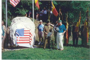Mitchell Kaidy, D-345 reading the tribute at the <br /> Bloody Crossroads, Pirompré, Belgium.<br /> <br /> Mitch wrote the texts for all four of the <br /> 87th Division Infantry plaques which were dedicated June 8, 1996 <br /> on the 87th Infantry Division Association Tour.