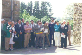 Here at the Tillet plaque Dedication - June 1996 are:<br />  <br /> (At left in green Jacket)- Jim Amor; A-345; <br /> the Assoc. Commander 1996. <br /> <br /> The Mayor of Ste Odeat at microphone. <br /> <br /> The two men at far right -Mitch Kaidy, D-345 (in blue shirt) and Bob Watson, I-346.