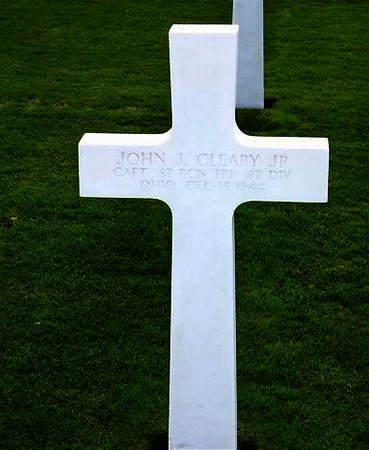 St. Avold - France<br /> <br /> JOHN J. CLEARY, JR. - Ohio<br />  Capt - 87th Rcn Trp <br /> 87th Division<br /> December 15, 1944<br /> <br /> JUNE - 2007 - per email from Karen (Gorman) Baker.<br /> Her Dad (Edward J. Gorman) was in the 345th Regiment (Company G). <br /> Karen said she just received the most recent Golden Acorn News, <br /> and one of the stories reminded her husband that he had taken pictures of these grave markers while on a trip to Europe several years ago. <br /> They are from 2 different military cemeteries (Hamm in Luxembourg and St. Avold in France). <br /> <br /> There is also a photo of the 87th Division plaque at the Bastogne memorial. <br /> <br /> She wanted to pass them along in tribute....and to anyone who might be interested. <br /> If any family member of these men see this - please let us know.<br /> <br /> Thanks to wonderful people like the Gorman's - who pull out their pictures and send them to this site - for all to view.