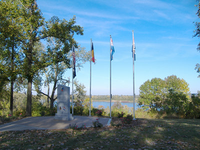 """Battle of the Bulge Monument<br /> Jefferson Barracks - St. Louis, Missouri<br /> 10-06<br /> <br /> Front of Monument looking out toward <br /> Mississippi River - This Monument is located in Jefferson Barracks - between the Amphitheatre and the Powder Magazine Museum.<br /> <br /> From what I have been told, and seen from looking at many other Battle of the bulge monuments, this is only monument that has inscribed all divisions and units involved in this battle.<br /> <br />  I would like to invite anyone out there to have their picture taken with the monument - and I would add them to this indiviual gallery! <br /> And let us know why the monument is special to you.<br /> <br /> And as always, any comments or general thoughts are always welcome to this site for all to read..<br /> Just click """"add comment"""" on lower left of this page."""