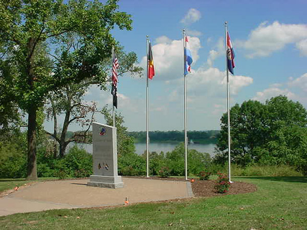 """9-06 - Jefferson Barracks - St. Louis, Missouri<br /> Front of Monument looking out toward <br /> Mississippi River - This Monument is located in Jefferson Barracks - between the Amphitheatre and the Powder Magazine Museum.<br /> <br /> From what I have been told, and seen from looking at many other Battle of the Bulge monuments, this is only monument that has inscribed all divisions and units involved in this battle.<br /> <br /> I would like to invite anyone out there to have their picture taken with the monument - and I would add them to this indiviual gallery!  <br /> And let us know why the monument is special to you.<br /> <br /> And as always, any comments or general thoughts are always welcome to this site for all to read..<br /> Just click """"add comment"""" on lower left of this page."""