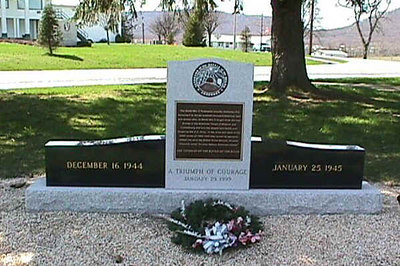 "Battle of the Bulge Monument  Fort Indiantown Gap Military Reservation  Ft. Indiantown Gap, PA  Home base of the 28th Infantry Division of the National Guard.  http://www.battleofthebulge.org/ gives this info:  Presented by the World War II Federation, the Battle of the Bulge Monument at the intersection of Clement Avenue & Fisher Road, on Fort Indiantown Gap Military Reservation honors the 81,000 American troops killed or wounded in the Battle of the Bulge in the Ardennes between December 16, 1944 and January 25, 1945.   Military officials and World War II veterans held a ceremony on January 25th, 1999 to dedicate the black and white marble monument called ""A Triumph of Courage.""    It also recognizes the 600,000 American men who fought three German Armies in the Ardennes Forest of Belgium and Luxembourg and won the largest land battle ever fought by the U.S. Army.    In the snow and sleet of the bitter winter of 1944-45, they turned an apparent defeat into what the British Prime Minister Winston Churchill called ""an ever famous American victory."""
