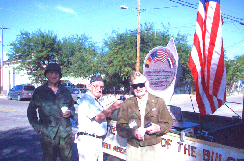 Veteran's of the Battle of the Bulge (VBOB)<br /> Chapter #53 - Southern Arizona members<br /> Veteran's Day Parade - November 11, 2006.<br /> <br /> Proud participants standing next to their float of the Replica of the <br /> Arizona VBOB Monument <br /> Left to Right:<br /> <br /> JOHN SWETT;<br /> 106th Inf. Div., 423 Inf. Reg., Co H (POW)<br /> <br /> BUCK BLOOMER<br /> 28th Inf. Div., 112th Reg.<br /> <br /> LEROY ELLIOT;<br /> 17th ABND, 155th AA Bn.