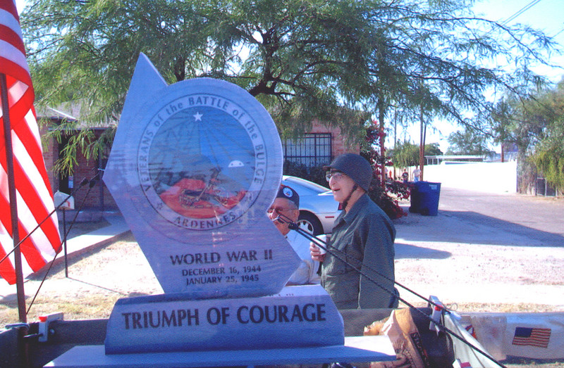 Veteran's of the Battle of the Bulge (VBOB)<br /> Chapter #53 - Southern Arizona members<br /> Veteran's Day Parade - November 11, 2006.<br /> <br /> Walking along with their float of the replica of the Arizona VBOB monument:<br /> <br /> BUCK BLOOMER (partially hidden) and JOHN SWETT