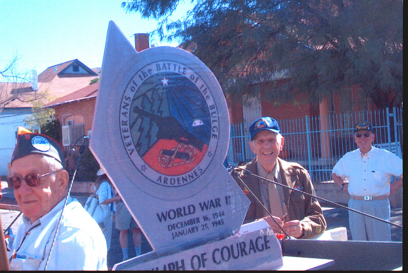 Veteran's of the Battle of the Bulge (VBOB)<br /> Chapter #53 - Southern Arizona members<br /> Veteran's Day Parade - November 11, 2006.<br /> <br /> Left to Right:<br /> <br /> BUCK BLOOMER;<br /> 28th Inf. Div., 112th Reg.<br /> <br />    Monument Replica<br /> <br /> GEORGE McGEE;<br /> 109th Evacuation Hospital, 3rd Army<br /> <br /> EUGENE PFLUGHAUPT;<br /> 30th Inf. Div.,120th Inf. Reg.,2nd Bn Co G