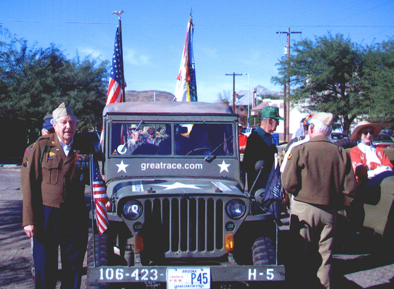 Veteran's of the Battle of the Bulge (VBOB)<br /> Chapter #53 - Southern Arizona members<br /> Veteran's Day Parade - November 11, 2006.<br /> <br /> BERNIE MEYER;<br /> 99th Inf. Div., 324th Engr. Combat Bat.<br /> <br /> He is standing next to the restored 1942 jeep used in the parade to pull the trailer that displayed the Arizona VBOB replica monument.