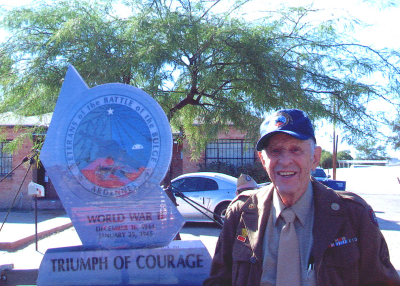 Veteran's of the Battle of the Bulge (VBOB)<br /> Chapter #53 - Southern Arizona members<br /> Veteran's Day Parade - November 11, 2006.<br /> <br /> GEORGE McGEE;<br /> 109th Evacuation Hospital, 3rd Army,<br /> proudly standing next to their float of the Replica of the <br /> Arizona VBOB Monument.