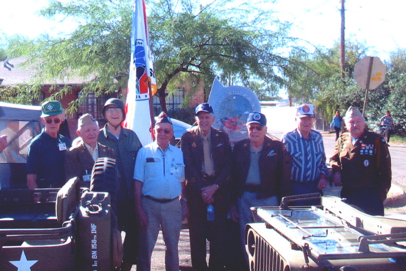 Veteran's of the Battle of the Bulge (VBOB)<br /> Chapter #53 - Southern Arizona members<br /> Veteran's Day Parade - November 11, 2006.<br /> <br /> Left to Right:<br /> <br /> HARPER COLEMAN;<br /> 4th Inf Div., 8th Reg., 2nd Bat., Co H<br /> <br /> LEROY ELLIOT;<br /> 17th ABND, 155th AA BN<br /> <br /> JOHN SWETT;<br /> 106th Inf. Div., 423 Inf. Reg., Co H (POW)<br /> <br /> BUCK BLOOMER;<br /> 28th Inf. Div., 112 Reg.<br /> <br /> GEORGE McGEE;<br /> 109th Evacuation Hospital, 3rd Army<br /> <br /> EARL HARTZ;<br /> 30th Inf. div., 120th Reg., 3rd Bat., Co K<br /> <br /> HERMAN VAN De BOGART;<br /> 106th Inf. Div., 424 Inf. Reg., Co A<br /> <br /> BERNIE MAYER;<br /> 99th Inf. Div., 324th Engr. Combat Bat.