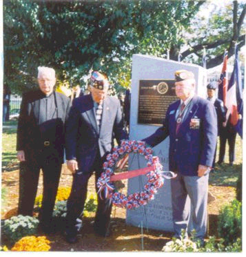 Worcester, Massachusetts<br /> Battle of the Bulge Monument Dedication<br /> October - 2003<br /> <br /> L-R:<br /> Rev. John J. Brooks SJ, President Emeritus of Holy Cross College.<br /> He gave the invocation and blessing.<br /> <br /> Middle:<br /> Lou Cunningham, 106th Infantry Division and then President of the National Veterans of the Battle of the Bulge. (VBOB)<br /> <br /> Right:<br /> John McAuliffe; 87th ID; M-347<br /> President of the <br /> Central Massachusetts Chapter-22; VBOB.