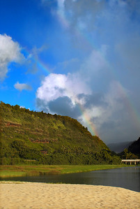 Rainbow over Waimea Bay, bridge on the Kamehameha Hwy on the North Shore of O'ahu, Hawai'i