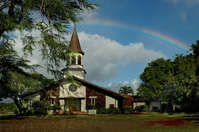 Rainbow over Liliu'okalani Protestant Church   Queen Liliuokalani, the first ruling queen and the last ruling monarch, presented the church with an unique clock placed on the rear wall of the church. One of the clock's seven dials uses the 12 letters of Queen Lili'uokalani's name in place of the 12 numbers to show the time. The other dials show the phases of the moon, the days of the month, week and year.   Halei'wa, North Shore, O'ahu, Hawai'i