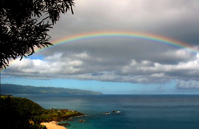 Rainbow from Spectacular north shore overlook. North Shore of O'ahu, Hawai'i
