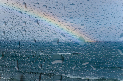 Rainbow at Sunset Point, through the window  North Shore of O'ahu, Hawai'i