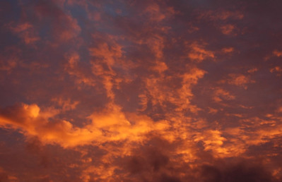 Bright Orange Clouds at sunset  North Shore of O'ahu, Hawai'i