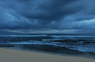 Dark Blue Cloudy Sky over a dark blue ocean at Sunset  North Shore of O'ahu, Hawai'i