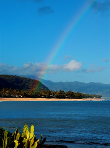 Rainbow over the ocean into Rocky Point by Sunset Beach, on the North Shore of Oahu, Hawaii North Shore of O'ahu, Hawai'i