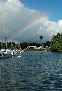 Rainbow over Anahulu Bridge in the Hale'iwa Harbor where sailboats are docked  North Shore, O'ahu, Hawai'i