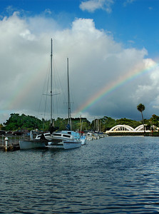 A rainbow appears over Anahulu Stream Bridge, or Rainbow Bridge,  a Hale'iwa landmark near the Hale'iwa Small Boat Harbor  North Shore, O'ahu, Hawai'i