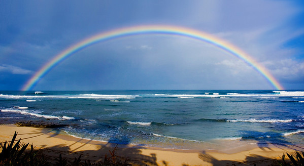 Rainbow off Sunset Point in the morning North Shore of O'ahu, Hawai'i