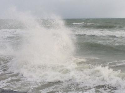 Waves hit the seawall