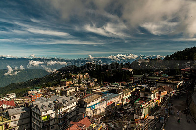 D10:Darjeeling town(West Bengal) basks in the morning sun aganst a backdrop of snow-capped Khangchendzonga and blue skies