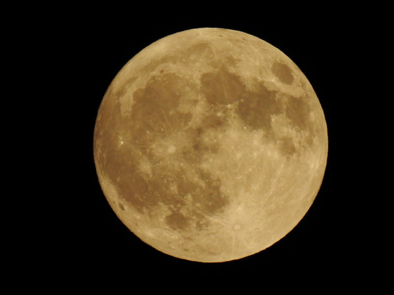 Here's a couple of yellow-ish pictures of the moon. I think it could pass for Harvest moon. This one was taken Friday night.