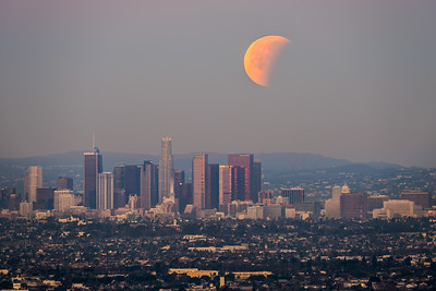 Partial lunar eclipse setting behind Los Angeles