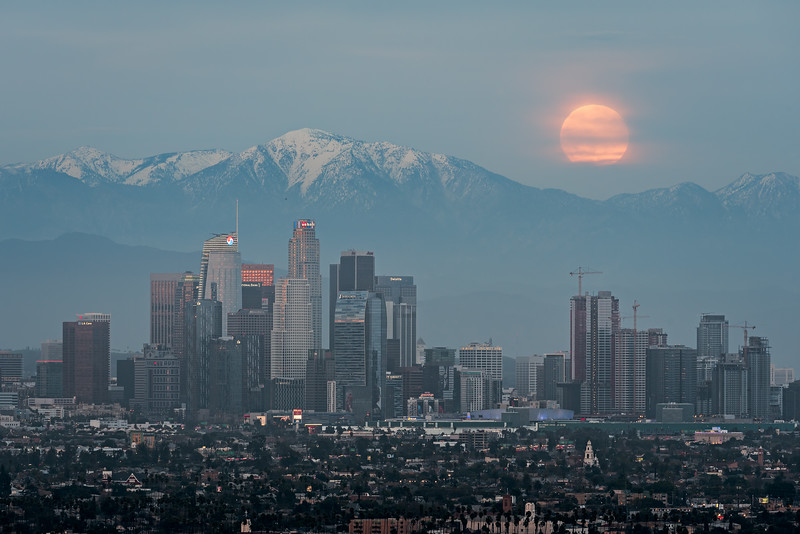 Full moonrise over Los Angeles and snow capped Mt. Baldy