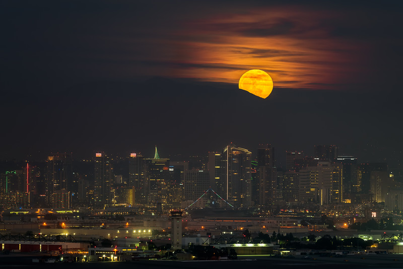 San Diego full Christmas moonrise over city