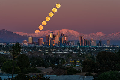Los Angeles sunset moonrise over snow capped Mt. Baldy