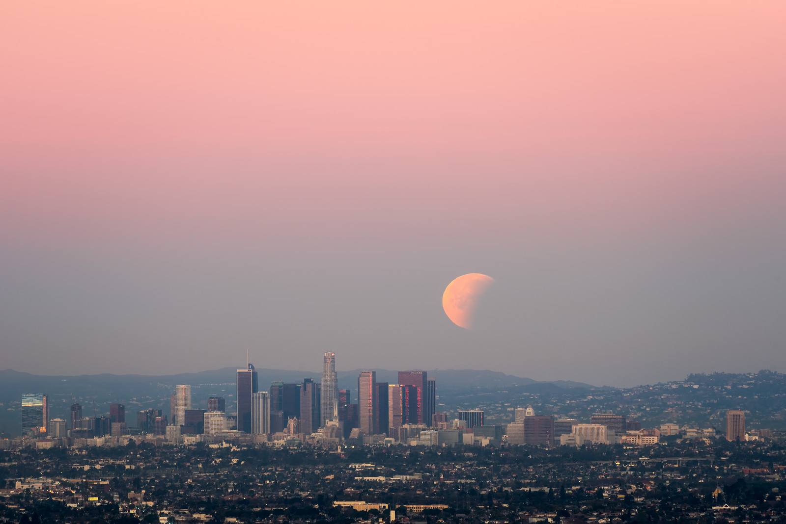 Partial Lunar Eclipse with alepnglow over Los Angeles skyline