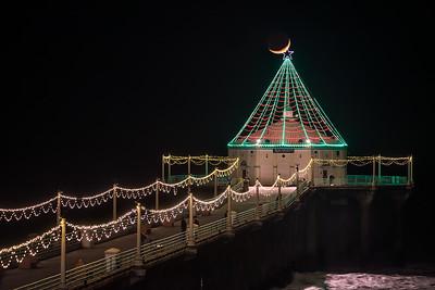 Crescent moonset over Manhattan Beach pier Christmas lights