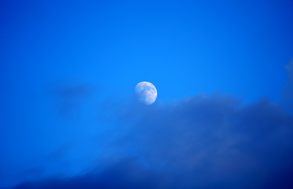 The moon emerges from the clouds for a daily display.