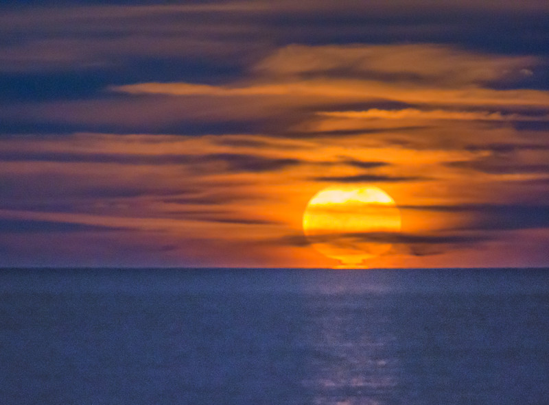 Rising Full Moon Amidst Clouds over Sea of Cortez