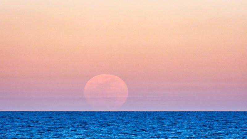 Full Moon Rising over Sea of Cortez Amidst Hazy Sky