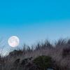Full Moon Setting over Sand Dunes