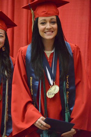 Southmoore senior Natalie Scott walks back to her seat after receiving her diploma Saturday evening during the Sabercats' graduation ceremony at the Cox Convention Center.<br /> Kyle Phillips/The Transcript