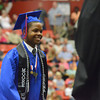 Quinton Finley walks to get his diploma as he and other seniors from Moore High School graduate Saturday afternoon at the Cox Convention Center in Oklahoma City.<br /> Kyle Phillips/The Transcript