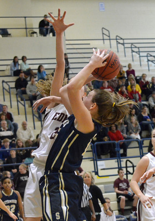 Southmoore's  Kyra Gilbert(15) shoots the ball during the Sabercats' game against Edmond Memorial Saturday during the Regional Tournament at Southmoore High School.<br /> Kyle Phillips/The Transcript