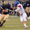 Southmoore running back Pierce Spead (10) tries to get by a Moore defender Friday during the Sabercats' game against the Lions at Moore Stadium.<br /> Kyle Phillips/The Transcript