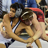 Westmoore's Dalton Duffield ties up Edmond North's Jordan Prince during the 106 lb match in the finals of the OSSAA 6A State Wrestling Tournament Saturday at the State Fair Arena in Oklahoma City.<br /> Kyle Phillips/The Transcript