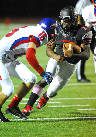 Westmoore's Kieron Hardrick (1) runs with the ball Thursday after making an interception during the Jaguars' game against Bixby at Moore Stadium.<br /> Kyle Phillips/The Transcript