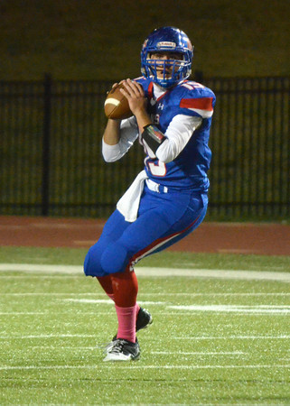 Moore High quarterback Colin Webb looks for an open receiver Friday night during the Lions' game against Lawton at Moore Stadium.<br /> Kyle Phillips/The Transcript