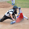 Moore High School's (9) slides safely into home as the Broken Arrow catcher misses the throw Friday during the Lions' game against the Tigers at ASA Hall of Fame Stadium.<br /> Kyle Phillips/The Transcript