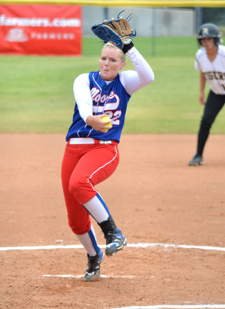 Moore High School's (22) pitches to a Broken Arrow batter Friday as the Lions' take on Broken Arrow during the 6A state fast pitch softball tournament at the ASA Hall of Fame Stadium in Oklahoma City.<br /> Kyle Phillips/The Transcript