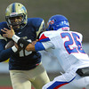Moore High's Keoni Walter (26) tackles Soutmoore's Pierce Spead (10) as he runs with the ball Friday during the Lions' game against Soutmoore at Moore Stadium.<br /> Kyle Phillips/The Transcript